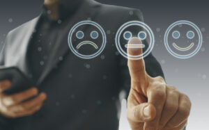 Businessman pointing at a neutral face icon, showing a concept of turning negative reviews.